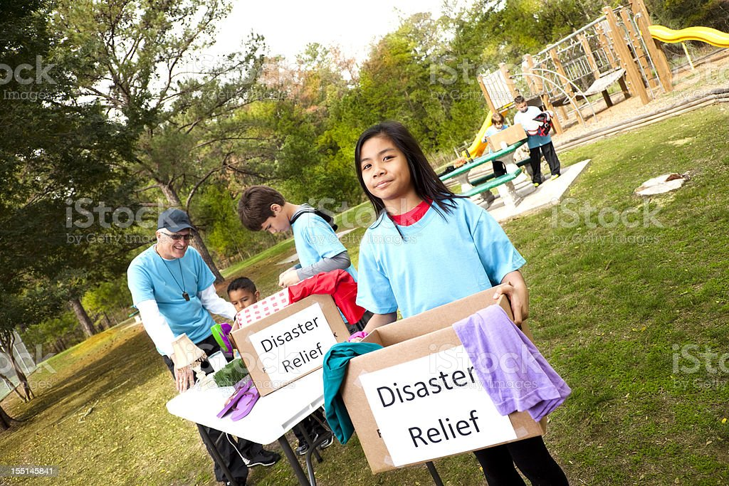 Sports team of children collecting donations for disaster victims. volunteers stock photo