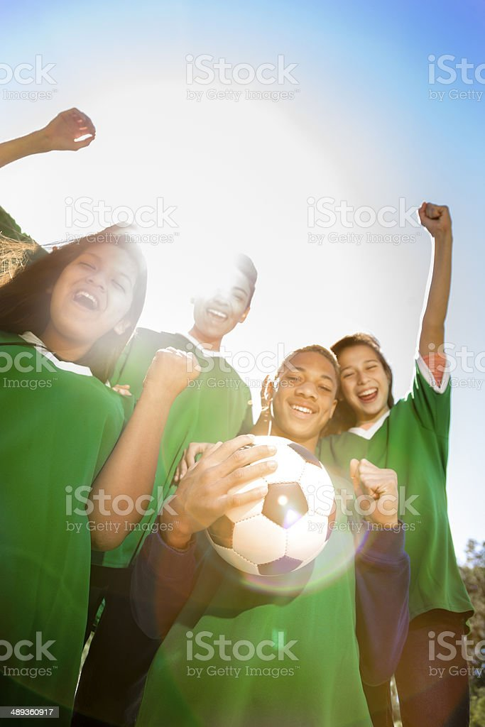 Sports: Teenage friends soccer team cheers a victory. royalty-free stock photo