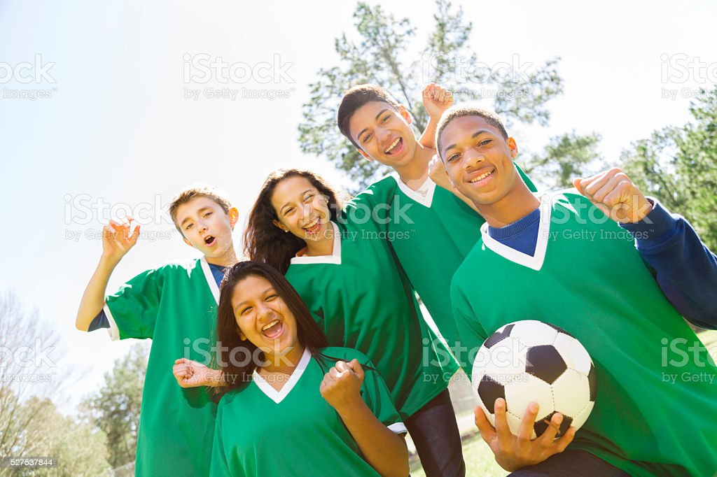 Sports: Teenage friends soccer team with park background. stock photo