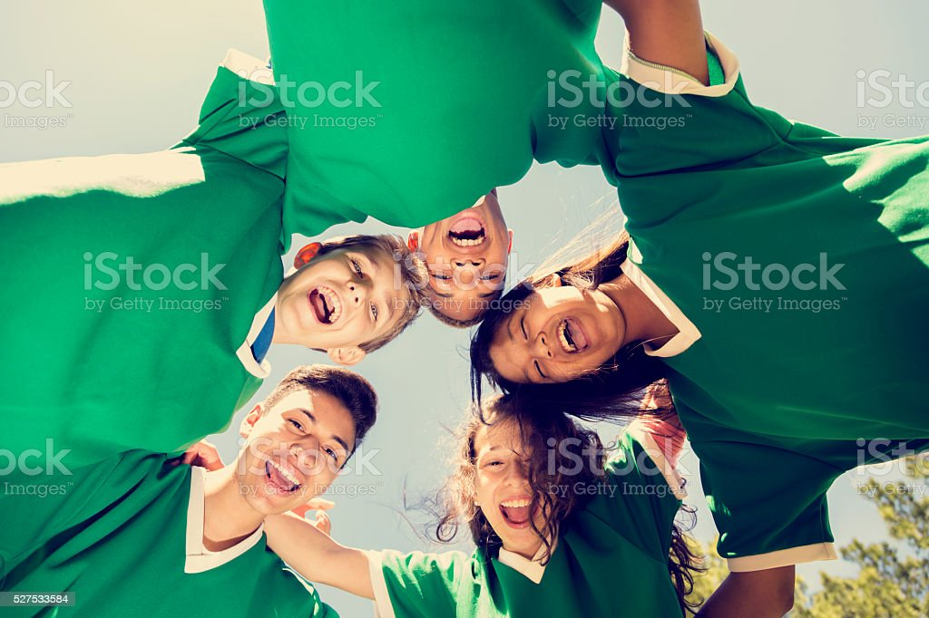 Sports: Teenage friends soccer team with sky, park background. stock photo