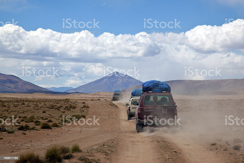 Sports Utility Vehicle Drinving in the Bolivian Altiplano royalty-free stock photo