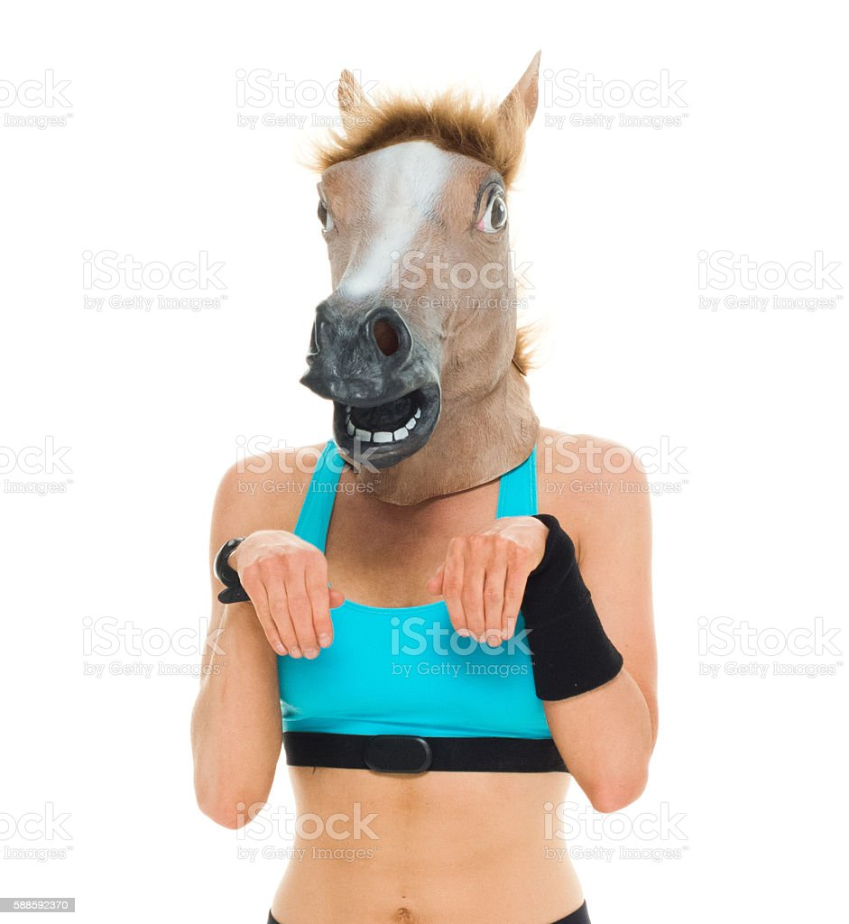 Sports woman acting like horse stock photo