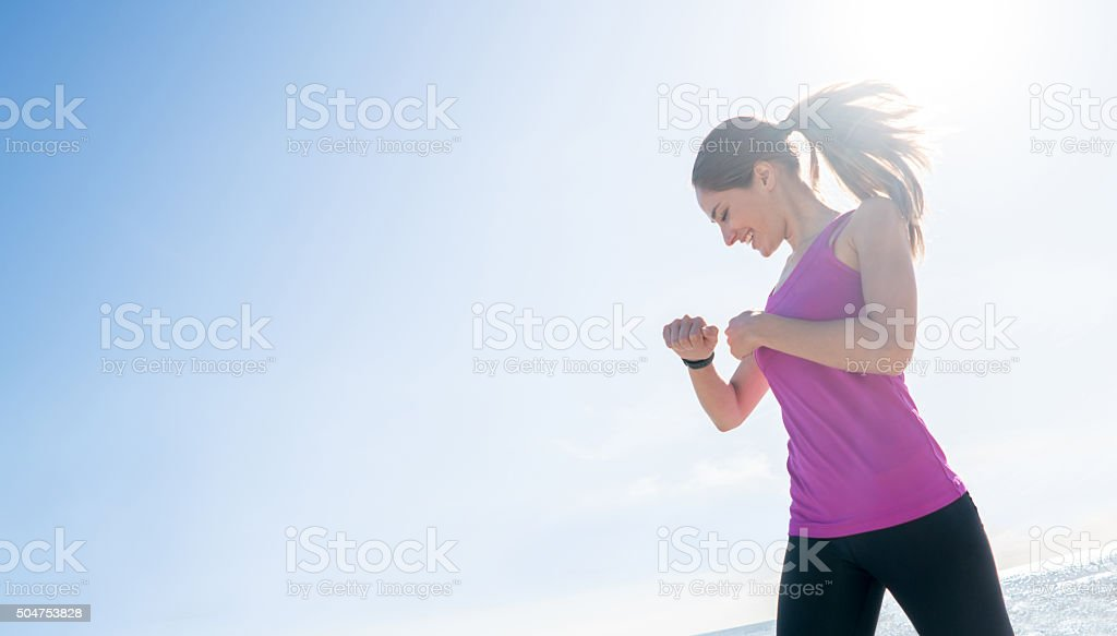 Sports woman checking her pulse on a smart watch stock photo