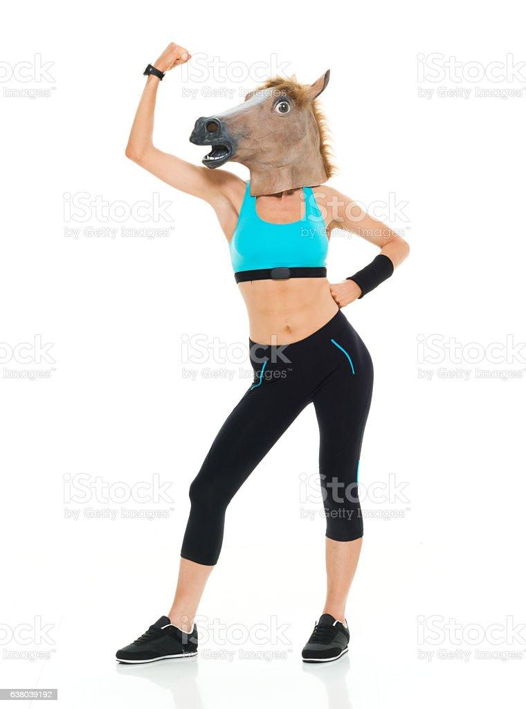 Sports woman flexing muscle stock photo