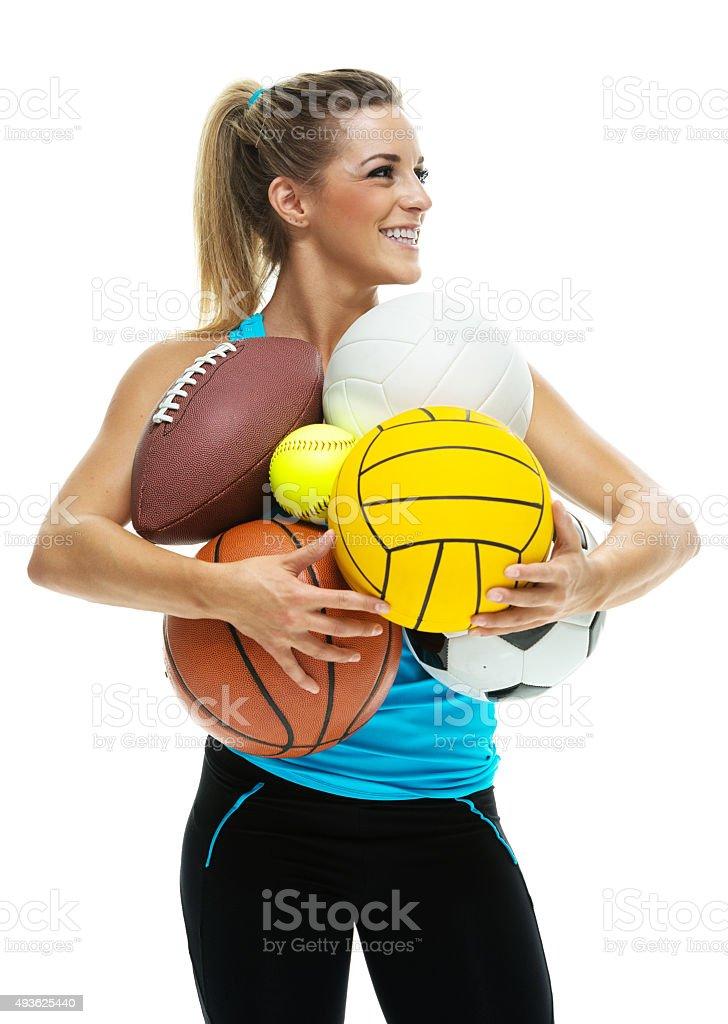 Sports woman holding balls stock photo