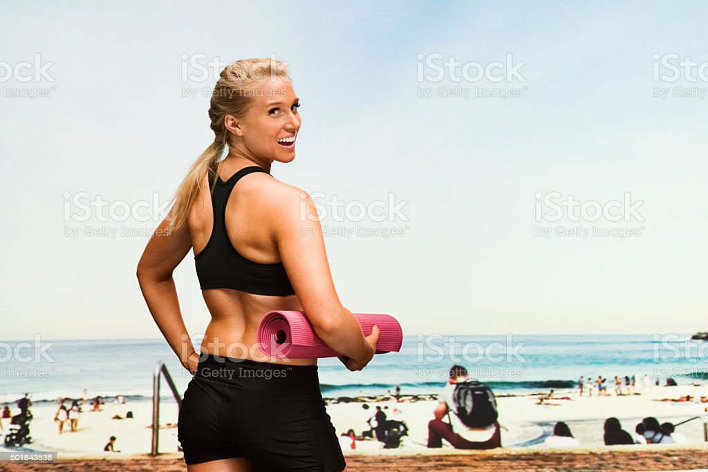 Sports woman in the beach and looking at camera stock photo