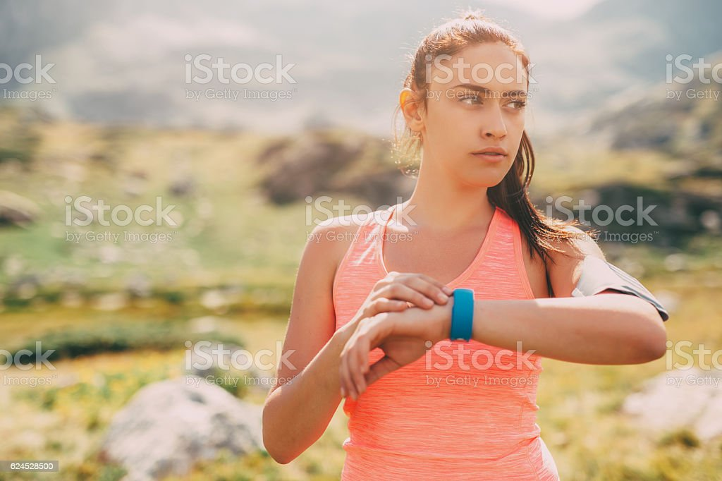 Sports woman in the mountain stock photo