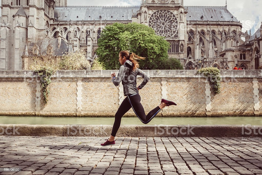 Sports woman jogging in Paris stock photo