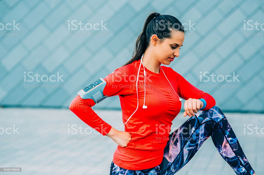 Sports Woman Looking At Her Watch stock photo