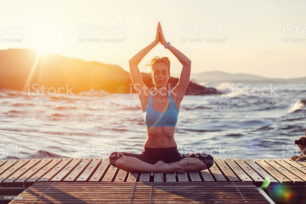Sports woman meditating in a prayer position stock photo