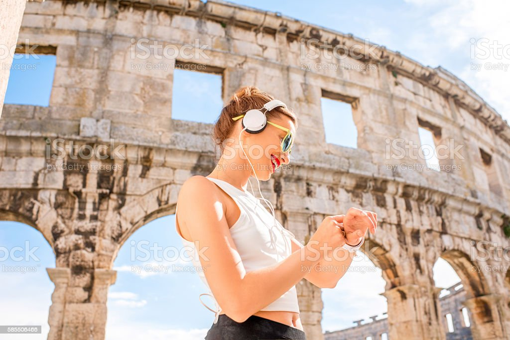 Sports woman near the amphitheatre stock photo