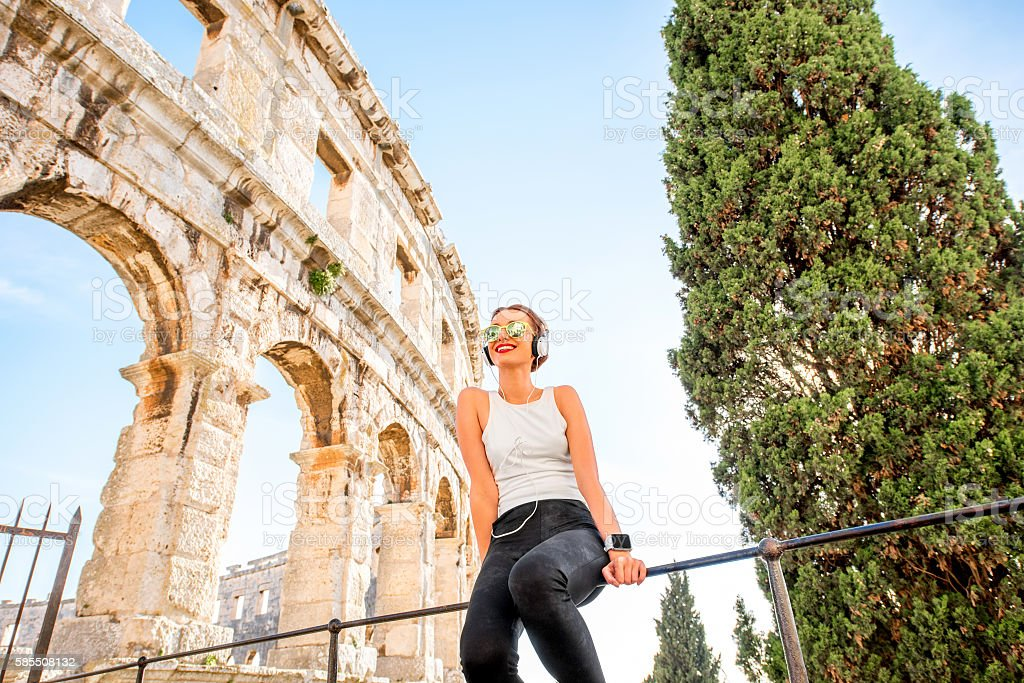 Sports woman near the amphitheatre stock photo