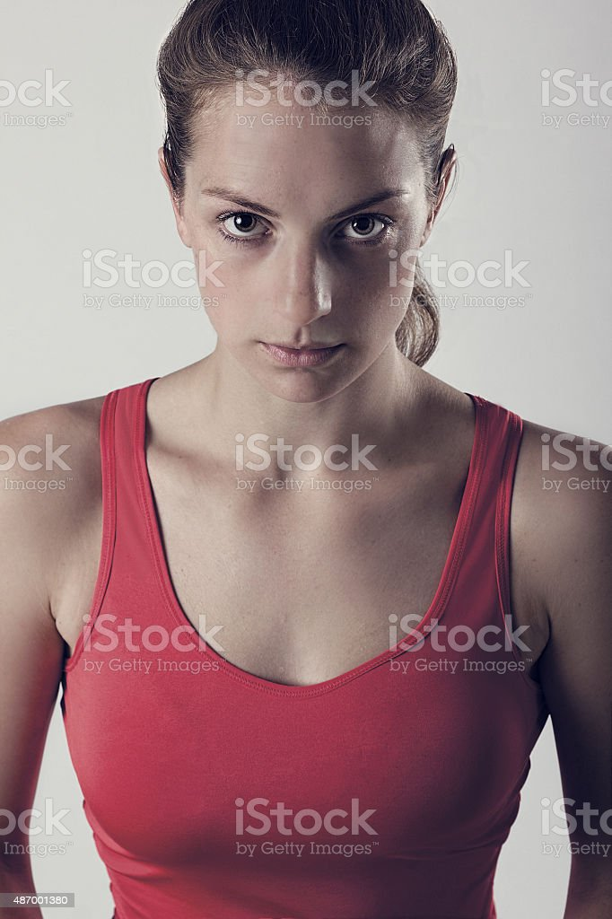 Sports Woman With Look Of Determination. Dark Gritty Portrait stock photo