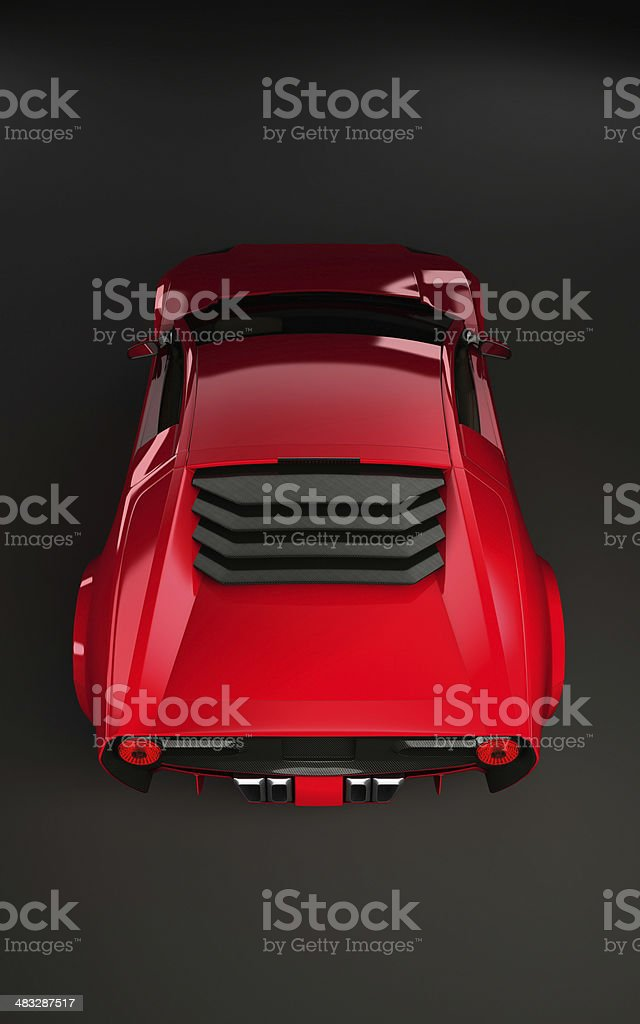 Sportscar in red on dark background from behind stock photo