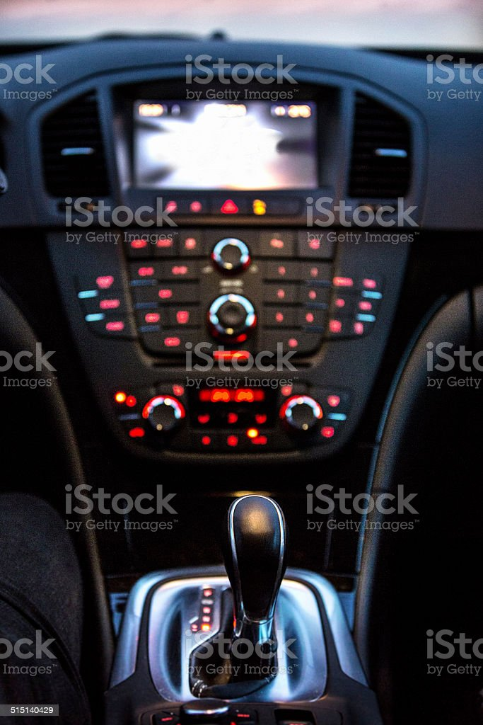 Sportscar instrument panel, gear shift, navi, vertikal stock photo