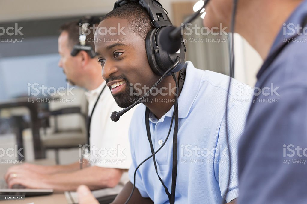 Sportscaster or assistant coach watching game in the media box stock photo