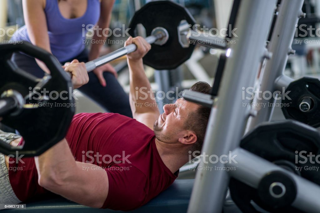Sportsman doing bench press at the gym. stock photo