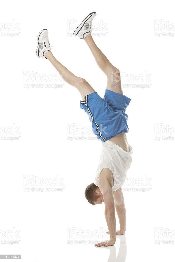 Sportsman doing handstand stock photo