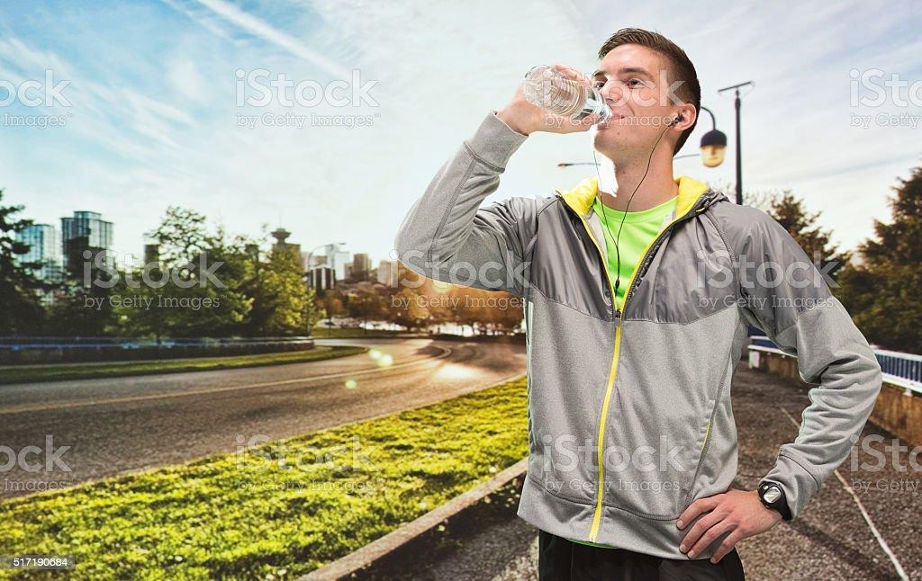 Sportsman drinking water stock photo