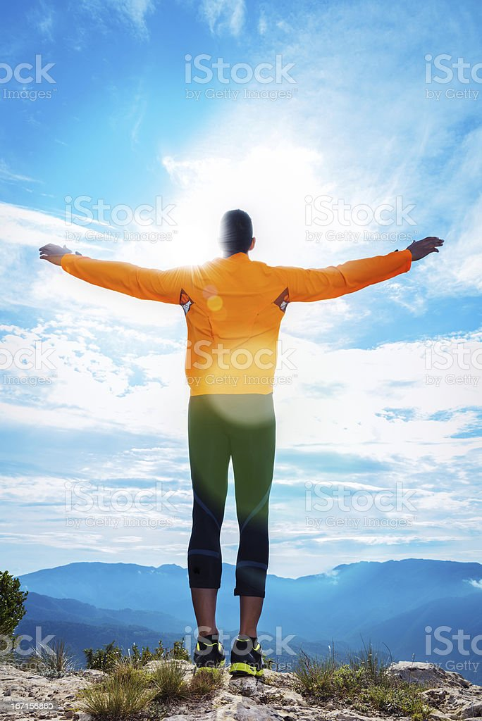Sportsman enjoying majestic landscape royalty-free stock photo