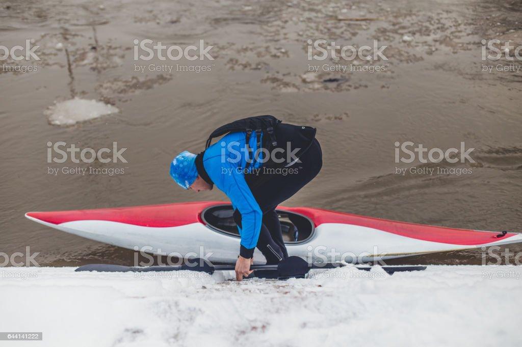 Sportsman going into his kayak stock photo