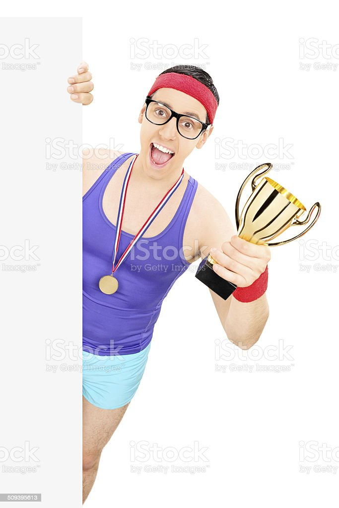 Sportsman holding trophy behind a panel stock photo