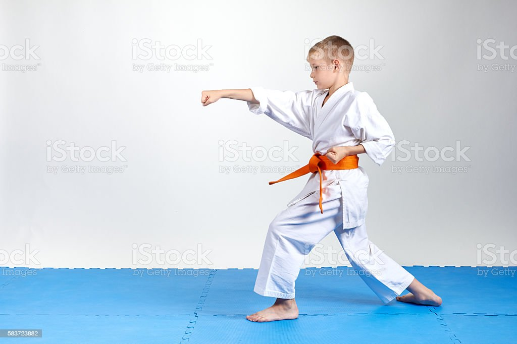 Sportsman in rack karate beats gyaku-tsuki stock photo