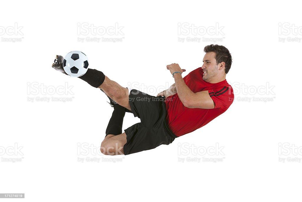Sportsman kicking a soccer ball stock photo