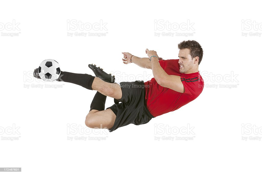 Sportsman kicking a soccer ball royalty-free stock photo
