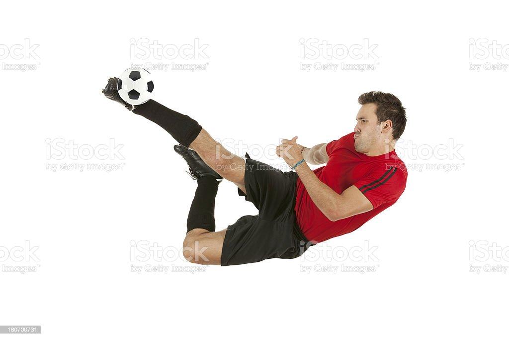 Sportsman kicking a soccer ball royalty-free stock photo