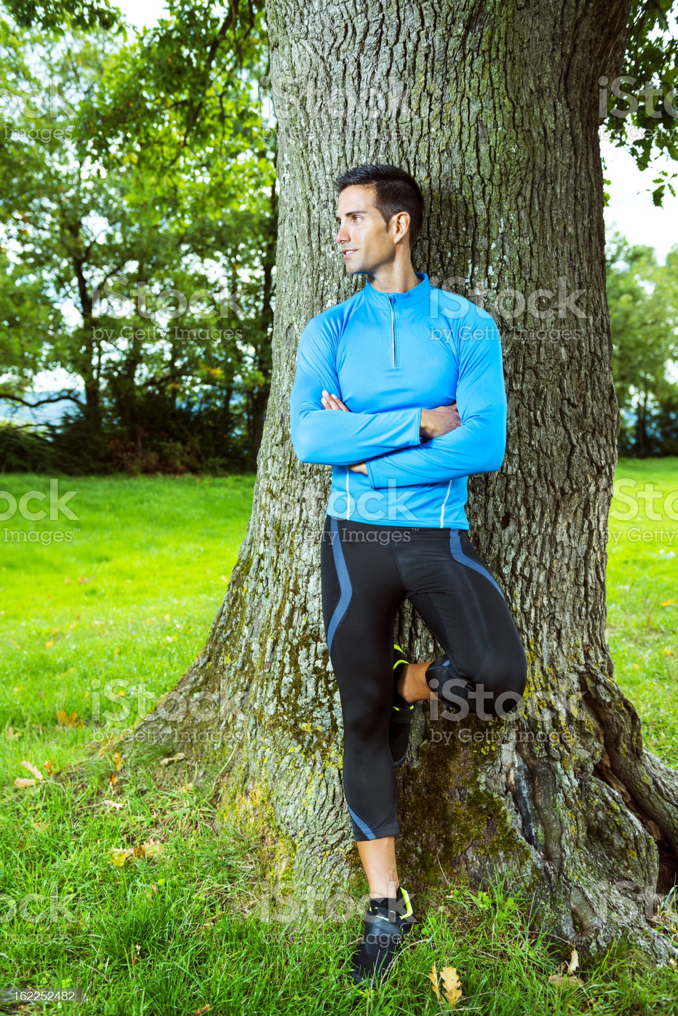 Sportsman resting after jogging outdoors. royalty-free stock photo