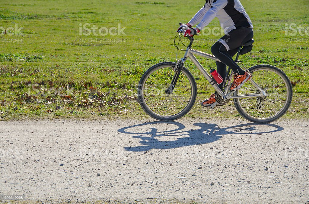 Sportsman riding bicycle stock photo