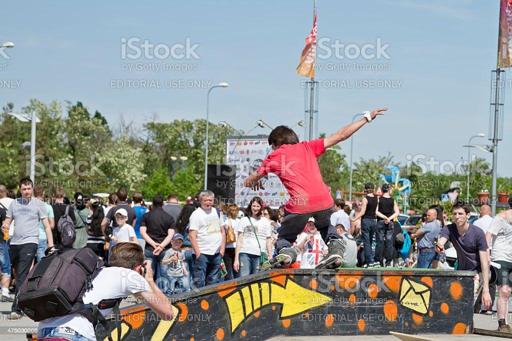 Sportsman roller performs the slide rail stock photo