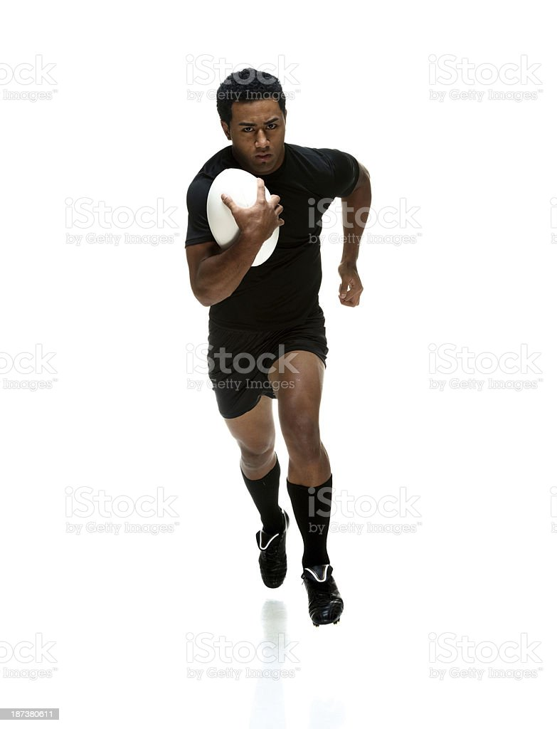 Sportsman running with rugby ball royalty-free stock photo