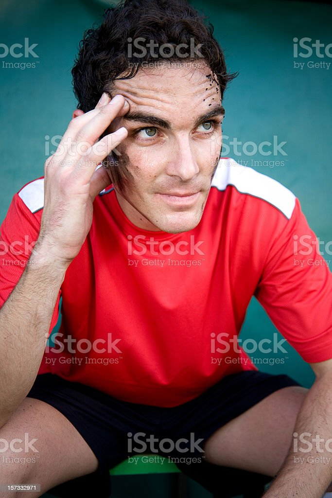 Sportsman sitting on a bench royalty-free stock photo