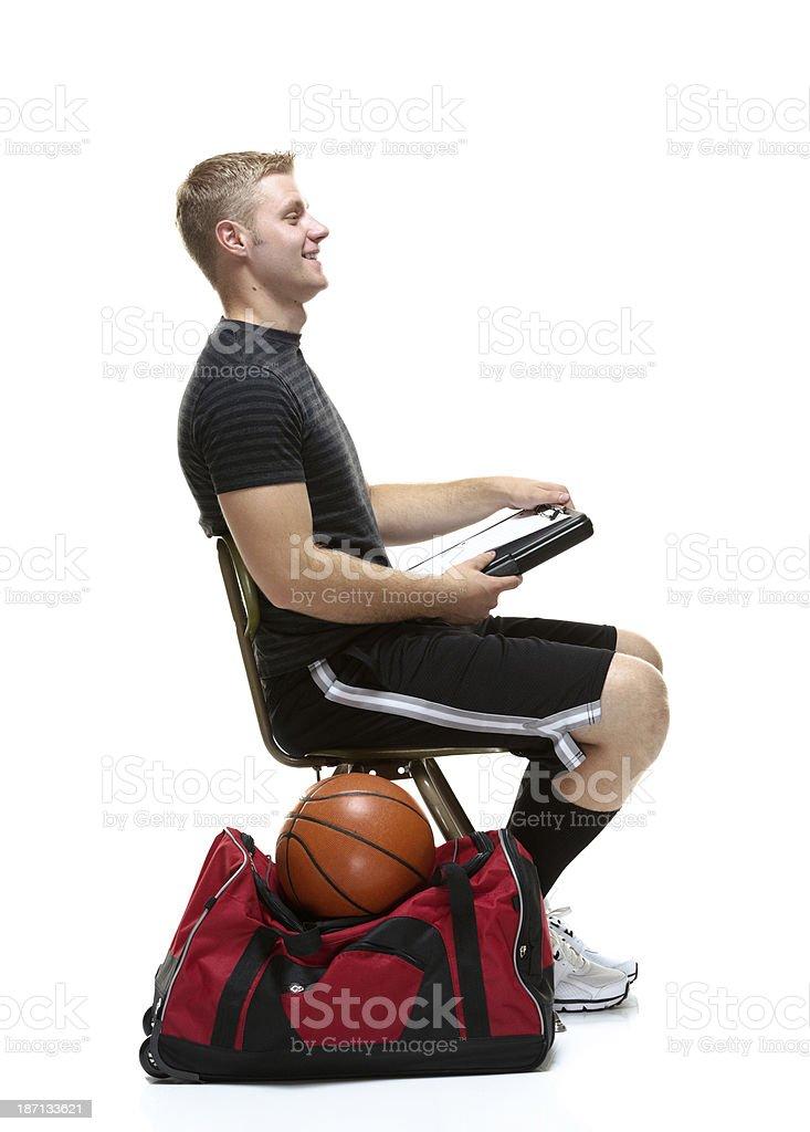 Sportsman sitting on chair stock photo
