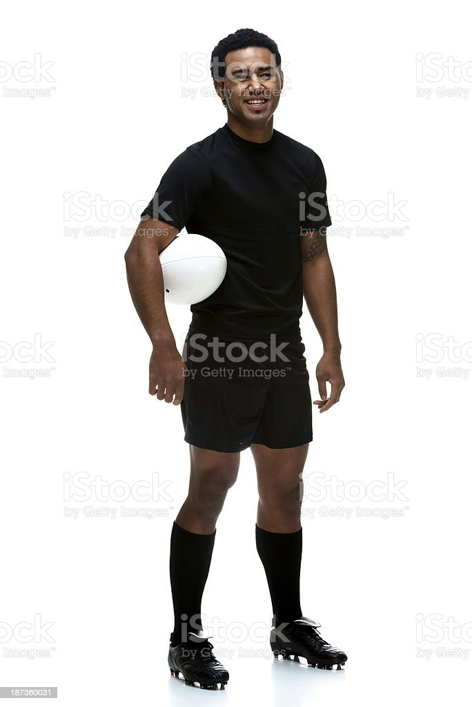 Sportsman standing with rugby ball royalty-free stock photo