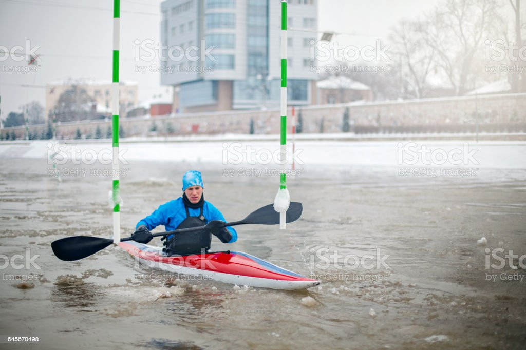 Sportsman training on extreme cold weater in kayak stock photo