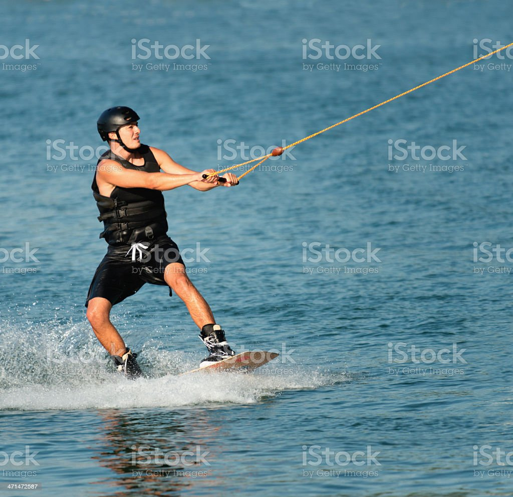 Sportsman wakeboarding royalty-free stock photo