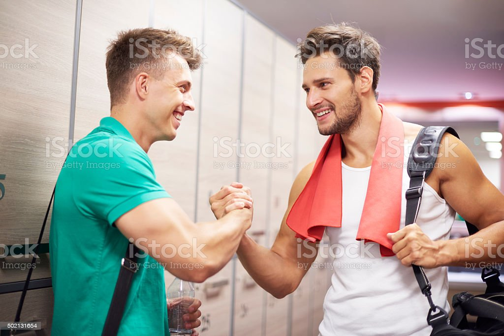 Sportsmen in the cloak room after the training stock photo