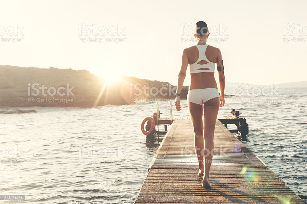 Sportswoman at the quay stock photo