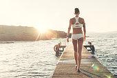 Sportswoman at the quay