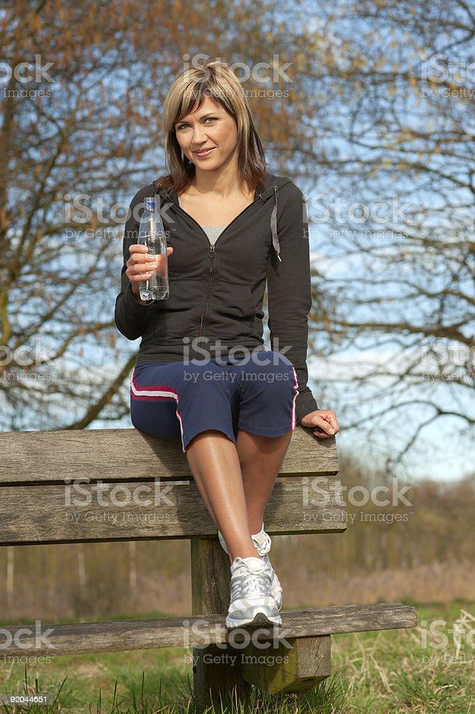 Sportswoman Drinking Water royalty-free stock photo