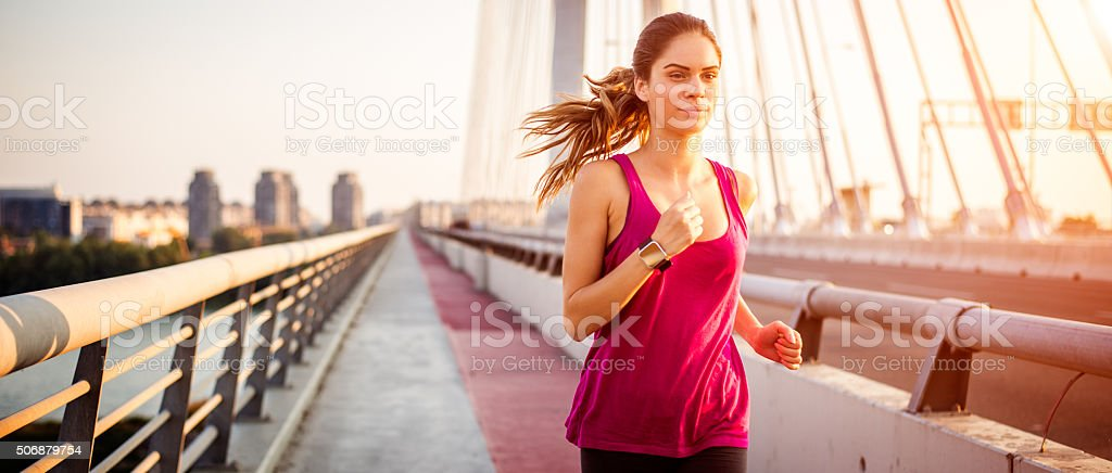 Sportswoman during jogging in the morning stock photo