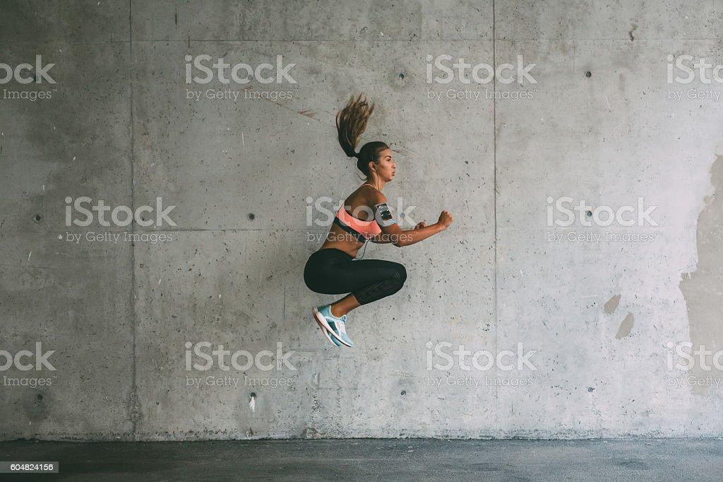 Sportswoman jumping stock photo