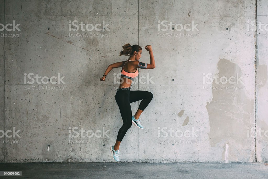 Sportswoman jumping stock photo