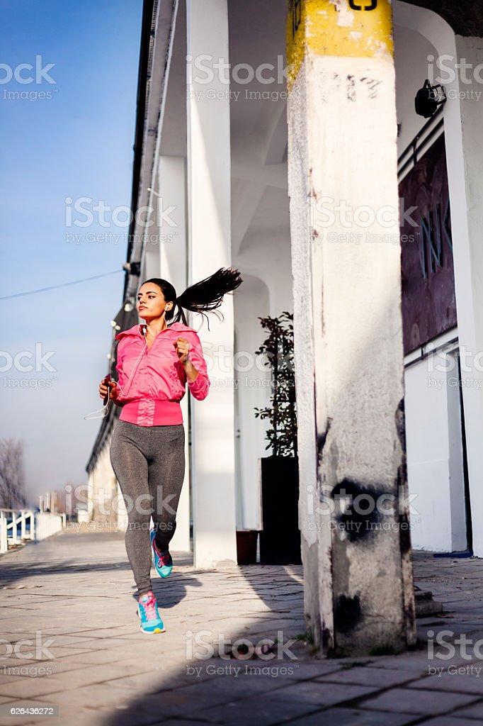 Sportswoman running royalty-free stock photo
