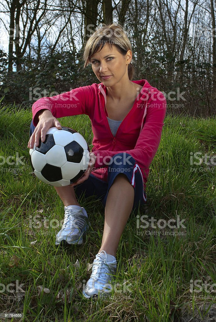Sportswoman Sitting with a Ball royalty-free stock photo