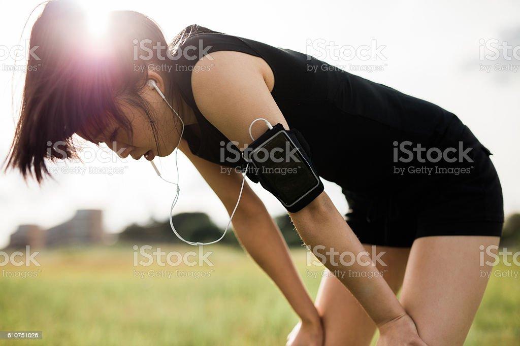 Sportswoman taking break from running workout. stock photo