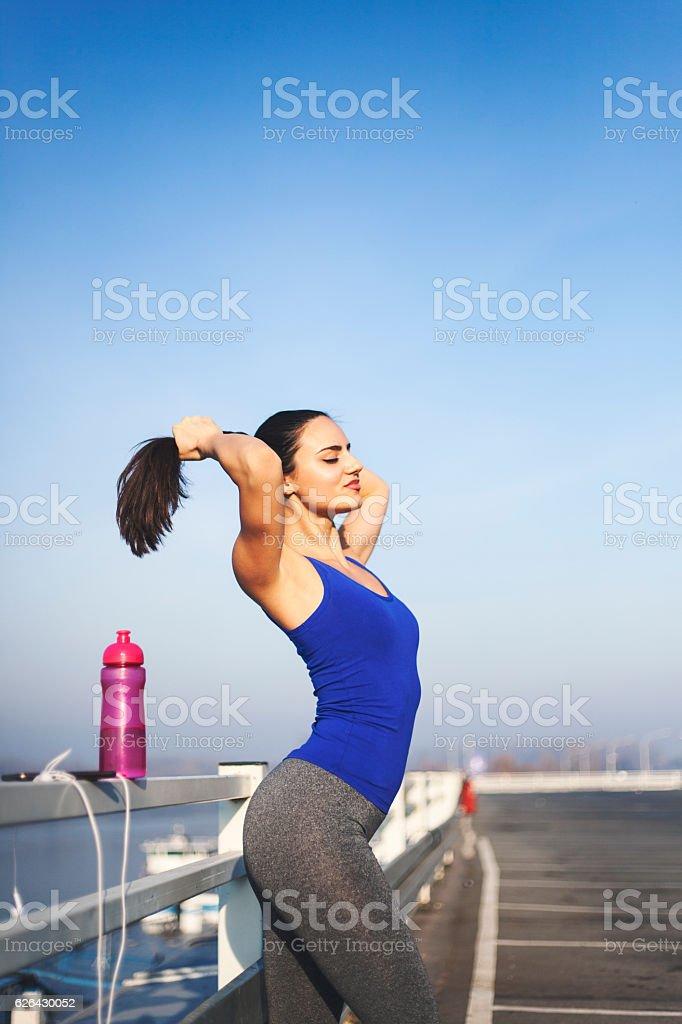 Sportswoman tying ponytail royalty-free stock photo